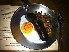 Black pudding with duck egg